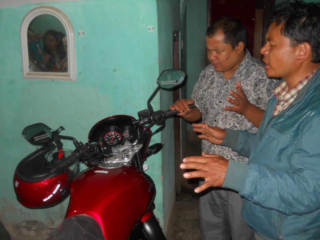 Ps. Purna from Bethel praying for the Ajays new Motor Cycle received from Romyen Church
